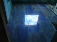 Dallage de salle de bains en Azul Macaubas en bandes de 40cm finition polie Chantier à Pont du Casse (47).